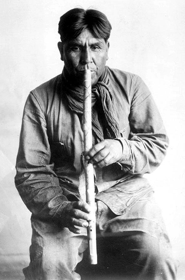 Cipriano Garcia playing a flute